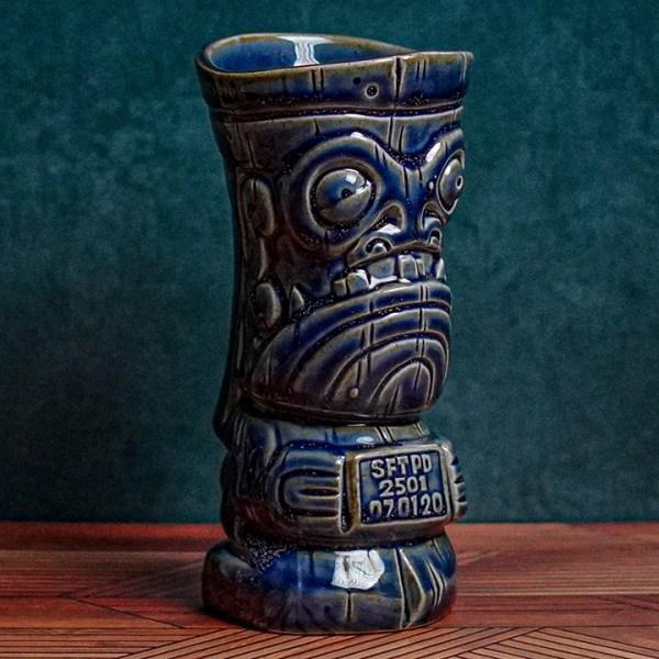 Angle of Mug Shot - The Search for Tiki - Jailbird Blue Edition