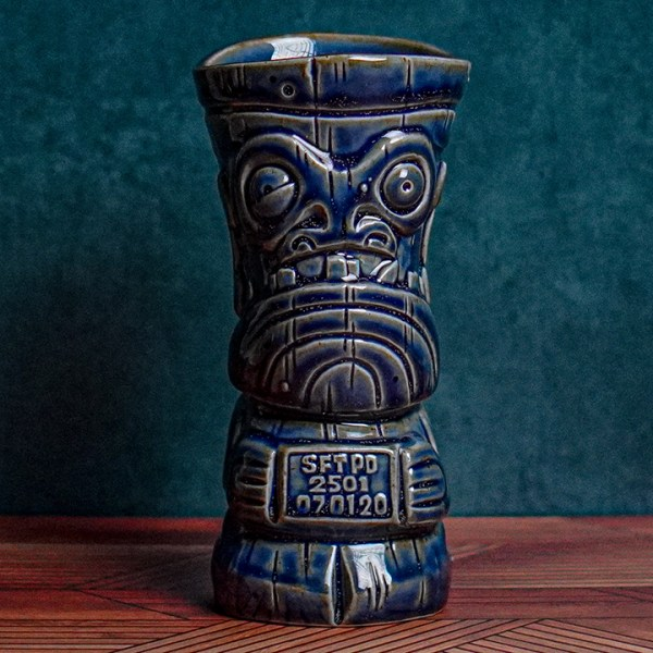 Front of Mug Shot - The Search for Tiki - Jailbird Blue Edition