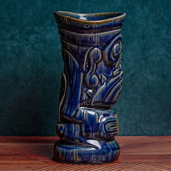 Side of Mug Shot - The Search for Tiki - Jailbird Blue Edition